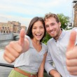 Couple giving thumbs up  in Stockholm — Stock Photo #54892839