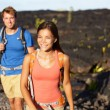 Couple walking on lava field — Stock Photo #54893179
