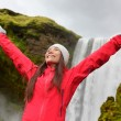 Woman near waterfall Skogafoss in Iceland — Stock Photo #54893441