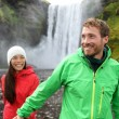 Couple holding hands near waterfall — Stock Photo #54893475