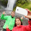 Couple taking selfie in front of Skogafoss — Stock Photo #54893499