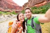 Happy couple taking selfie while hiking — Stock Photo