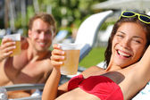People drinking beer at beach — Foto Stock