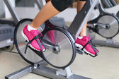 Woman biking in fitness center — Stock Photo