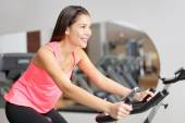 Woman excising with bike — Stock Photo