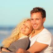 Couple relaxing at beach — Stock Photo