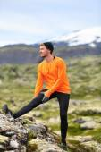 Runner stretching legs after running — Stock fotografie