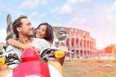 Lovers driving scooter on honeymoon — Stockfoto