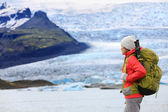Hiking woman near glacier in Iceland — Stock Photo