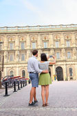 Tourists taking photo of Stockholm Royal Palace — Stock Photo