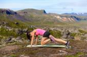 Woman doing exercises in nature — Foto Stock