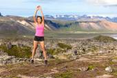 Woman jumping in amazing nature landscape — Stock Photo