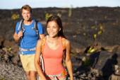 Couple walking on lava field — Stock Photo