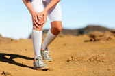 Man running outdoors. Sports injury — Stock Photo