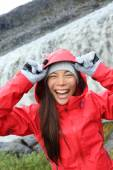 Woman laughing in raincoat near Dettifoss waterfall — Stock Photo