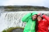 Couple in raincoats near Dettifoss waterfall — Stock Photo