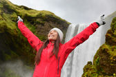 Woman near waterfall Skogafoss in Iceland — Stock Photo
