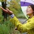 Woman with umbrella walking in forest — Stock Video #55033427