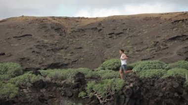 Man running in nature landscape — Stock Video