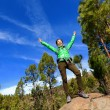 Woman celebrating on mountain top — Stock Photo #55353437