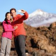 Couple taking selfie in beautiful nature — Stock Photo #55353621
