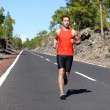 Runner jogging outdoors on road — Foto Stock #55353773