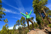 Woman celebrating on mountain top — Stock Photo