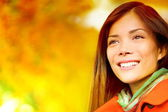 Fall woman in colorful foliage — Stockfoto