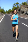 Female runner jogging on road — Stock Photo