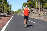 Runner jogging outdoors on road — Foto de Stock