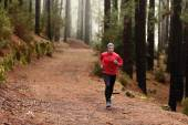 Man running in forest — Stock Photo