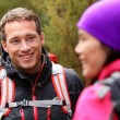 Male hiker talking with woman — Stock Photo #62143159