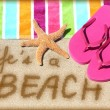 LIFE IS A BEACH written in sand — Stock Photo #62143447
