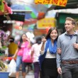 Tourists shopping in street market — Stock Photo #62143561