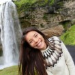 Woman in Icelandic sweater by waterfall — Stock Photo #62143587