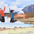 People jumping of joy in nature — Stock Photo #62143637