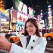 Woman taking photo in New York — Stockfoto #62143729