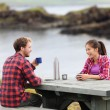 Camping couple sitting at table — Stock Photo #62143743