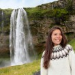 Woman in Icelandic sweater by waterfall — Stock Photo #62143773