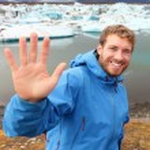 Tourist waving hand by Jokulsarlon — Stock Photo #62143897