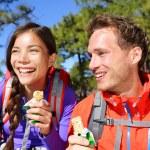 Couple eating muesli bar hiking — Stock Photo #62143959