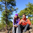 Hikers couple relaxing eating lunch — Foto Stock #62144007