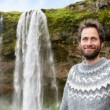 Man in Icelandic sweater by waterfall — Stockfoto #62144015