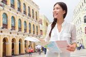 Tourist holding travel map in Macau — Stock Photo