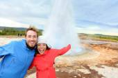 Tourists have fun by Strokkur geyser — Stock Photo