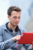 Professional man using tablet computer — Stock Photo
