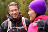 Male hiker talking with woman — Stock Photo