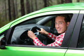 Man driving new vehicle — Stock Photo