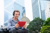 Man talking on tablet pc — Stock Photo