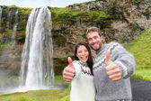 Couple thumbs up wearing Icelandic sweater — Stock Photo